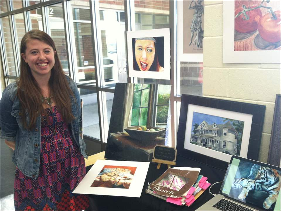 Senior Sarah Conners with her artwork.