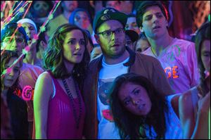 Rose Byrne and Seth Rogen in a scene from 'Neighbors.'