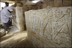An Egyptian conservator cleans limestones at a newly-discovered tomb dating back to around 1100 B.C. at the Saqqara archaeological site, 19 miles south of Cairo, Egypt, today.