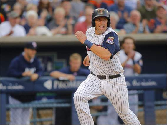 Toledo Mud Hens player Mike Hessman races for home on a double by teammate Tyler Collins.