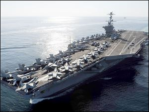 The Nimitz-class aircraft carrier USS John C. Stennis travels the Strait of Hormuz in 2011. The Pentagon has dealt with Iranian warnings to attack U.S. aircraft carriers in the Persian Gulf for more than 30 years.  Officials say the latest threat would have 'zero impact on U.S. Navy operations.'