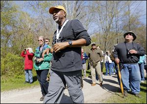 Doug Gray of Franklin, Ind., leads a birding-themed guided walk at Swan Creek Metropark. Most of the Biggest Week in American Birding's sites are in Ottawa County, but Lucas County businesses also are seeing a boost.