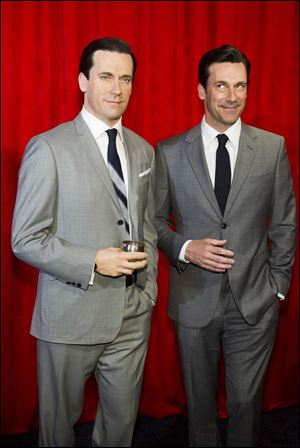Jon Hamm, right, poses with his wax likeness at an unveiling at Madame Tussauds on today in New York.