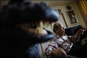 Original Godzilla suit actor Haruo Nakajima, who has played his role as the monster, speaks during an interview at his home in Sagamihara, near Tokyo. Nakajima, 85, was a stunt actor in samurai films, when he was approached to take the Godzilla role. He had to invent the character from scratch, and went to the zoo to study the way elephants and bears moved.