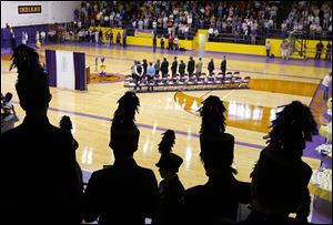 The Waite High School marching band prepares to play the alma mater during a rededication  ceremony of the school in the Grant Murray Field House.