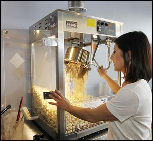 Rachel Marciniak-Matthews makes popcorn in 30 flavors in her Rachel Michael's  Gourmet Popcorn store on Monroe Street. She used to sell her popcorn from her home and online.