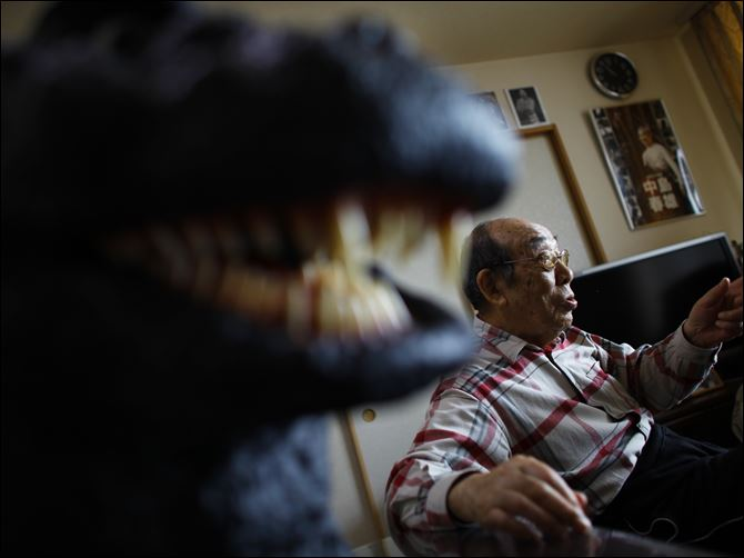 Japan American Godzilla Original Godzilla suit actor Haruo Nakajima, who has played his role as the monster, speaks during an interview at his home in Sagamihara, near Tokyo. Nakajima, 85, was a stunt actor in samurai films, when he was approached to take the Godzilla role. He had to invent the character from scratch, and went to the zoo to study the way elephants and bears moved.