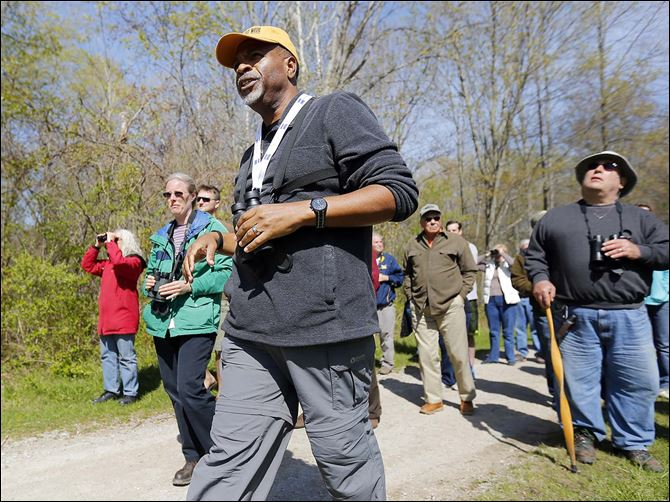 11n1gray-1 Doug Gray of Franklin, Ind., leads  a birding-themed guided walk at Swan Creek Metropark. Most of the Biggest Week in American Birding's sites are in Ottawa County, but Lucas County businesses also are seeing a  boost.