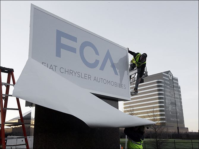 Fiat Chrysler Automotive HQ Workers unveil the Fiat Chrysler sign at Chrysler World Headquarters in Auburn Hills, Mich. The company aims to boost global sales from 4.4 million vehicles in 2013 to 7 million by 2018.