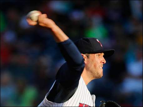 Toledo Mud Hens pitcher Drew VerHagen throws during the first inning against the Rochester Red Wings.