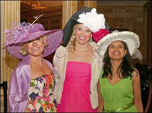 Regan Zhemedak, of Plymouth, Mich., left, Kristina Hertlein, center, and Aparna Brown, both of Ottawa Hills, right, attended the annual Kentucky Derby party at the Toledo Museum of Art.