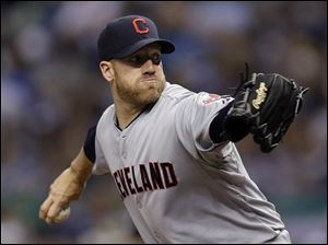 Cleveland Indians starting pitcher Zach McAllister goes into his windup against Tampa Bay Rays' David DeJesus.