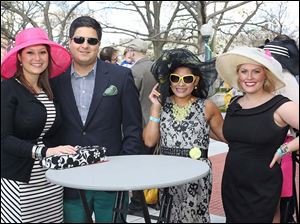 Monica Schaupp, left, Stephen Vasquez, center left, Denise Alvardo, center right, and Sara Swisher, right, attended the Circle 2445'€™s annual Kentucky Derby party at the Toledo Museum of Art in Toledo.