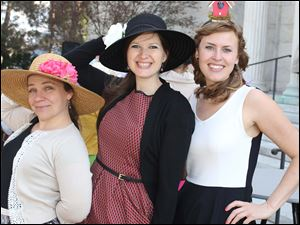 Amy Duvendack, left, Ashley Pfund, center, and Jaci Riley, right, attended the Circle 2445's annual Kentucky Derby party at the Toledo Museum of Art in Toledo.