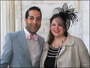 Amir Khan, of Sylvania, left, and Ashley Kasperzak, of New York, right, attended the Circle 2445's annual Kentucky Derby party at the Toledo Museum of Art in Toledo.