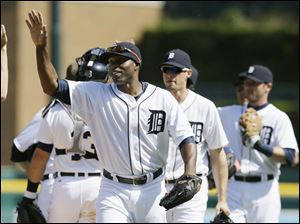 Detroit Tigers right fielder Torii Hunter leads teammates off the field after their 9-3 win over the Minnesota Twins.