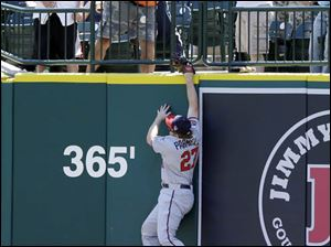 Minnesota Twins right fielder Chris Parmelee reaches but is unable to catch a 3-run home run by Miguel Cabrera.