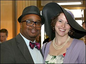 Joshua Peterson, of the Old West End, left, and Jennifer Less, of Ann Arbor, attended the annual Kentucky Derby party at the Toledo Museum of Art.