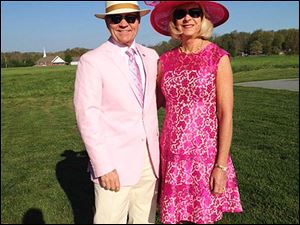 Tom and Sandi Sydlowski dressed in pink to support Breast Cancer Survivors which was the theme for the running of the 140th Oaks which is run the day before the Kentucky Derby.