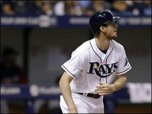 Wil Myers flips his bat after hitting a double off Cleveland Indians' Zach McAllister.