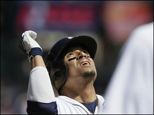 Detroit Tigers designated hitter Victor Martinez looks skyward as he crosses home plate after his three-run home run.