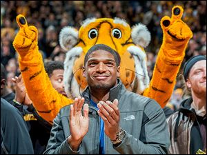 Michael Sam, appearing at a Missouri basketball game in February, was the SEC's defensive player of the year. His team kept secret that he was gay, something that he disclosed earlier this year.