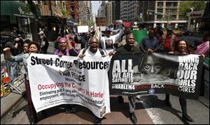 Demonstrators arrive in front of the Nigerian consulate after marching from Harlem during a rally today in New York.