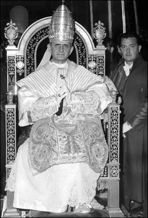 Pope Paul VI sits on his throne outside St. Peter's Basilica during ceremonies marking his 1963 coronation.