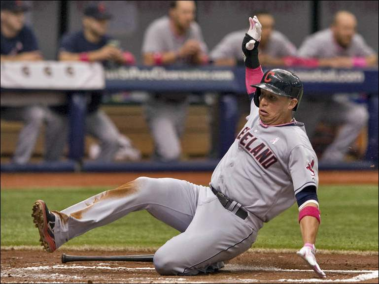 Cleveland Indians' Asdrubal Cabrera scores on Nyjer Morgan's RBI-single.