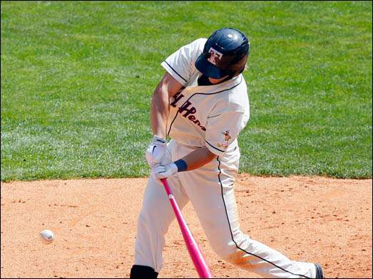 Mud Hens' Jordan Lennerton uses a pink bat to connect with the ball.