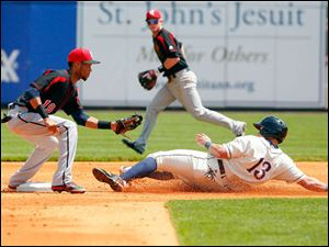Mud Hens' James McCann slides to second while Rochester Red Wings' Pedro Florimon tries to tag him out.