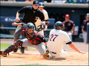 Mud Hens Mike Hessman slides past home and the tag of Rochester Red Wings' Eric Fryer.