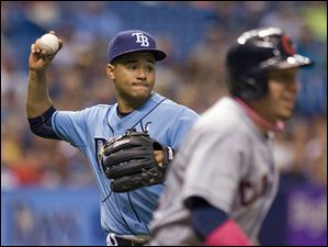 Rays pitcher Chris Archer, left, throws out Cleveland Indians' Asdrubal Cabrera, right, on a come-backer to the mound.