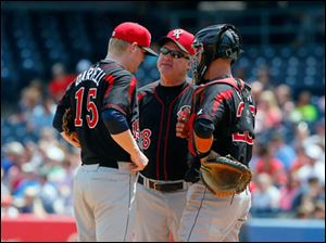 Rochester Red Wings' pitching coach Marty Mason, center,  talks to pitcher Logan Darnell, left, and catcher Eric Fryer, right.
