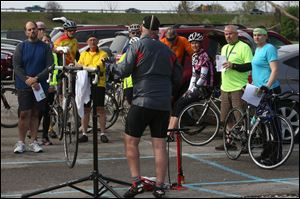 Toledo Area Bicyclists member Brian Gribble, center, leads a workshop Saturday at Fort Meigs YMCA in Perrysburg. The clinic included a primer on the rules of the road, safety tips and general cycling etiquette.