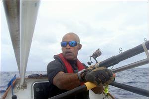 Victor Mooney rows the Spirit of Malabo in the Atlantic Ocean.