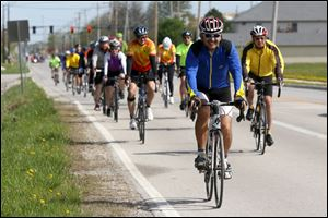John Gray of Oregon leads bicyclists making their way down Fort Meigs Road during Saturday's safety workshop in Perrysburg. The event was for participants in the upcoming Bike to the Bay fundraiser.