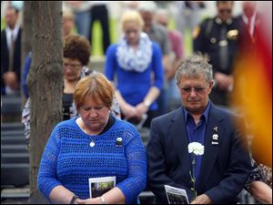 Larraine Dressel, left, and Mike Dressel, right, parents of Detective Keith Dressel who died in the line of duty in 2007.