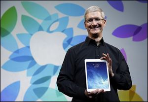 Apple CEO Tim Cook introduces the new iPad Air in San Francisco.