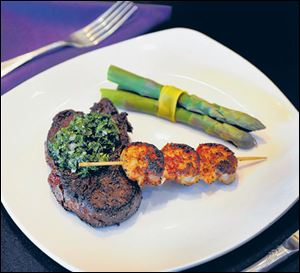 Steak with chimichurri, asparagus, blackened shrimp.