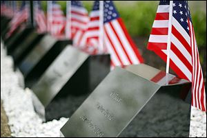 Flags adorn the memorial stones during the memorial ceremony.