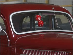 Many of the 1936 Ford cars came with fuzzy dice in the windows.