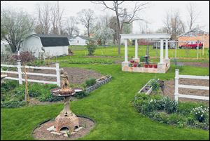 The backyard garden is divided into four quadrants.