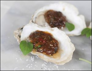 Grilled Oysters with Miso Black Beans and Chili Garlic.