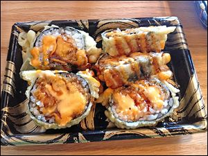 The spicy tempura roll at Sakura Express in Maumee features spicy ground salmon and  tuna, wrapped in a seaweed sheet and is coated in a tempura shell.