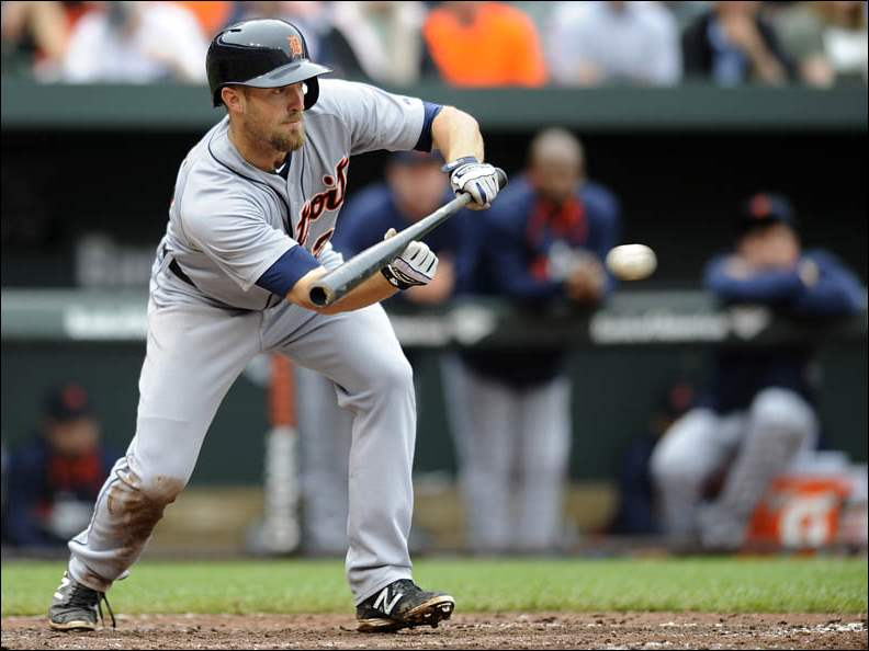 Detroit Tigers' Danny Worth bunts for a single.