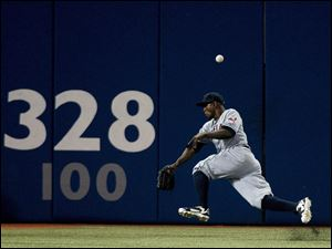 Cleveland Indians left fielder Michael Brantley misses the ball on a double by Toronto Blue Jays' Adam Lind.