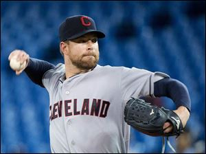 Cleveland Indians starting pitcher Corey Kluber works against the Toronto Blue Jays.