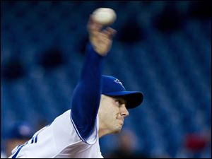 Blue Jays starting pitcher Dustin McGowan works against the Cleveland Indians.
