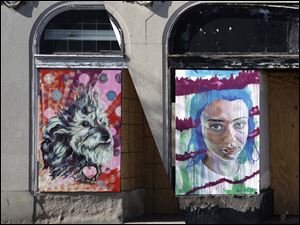 Murals by student and adult artists are sprucing up East Toledo's business district. LeSo Gallery is spearheading installation of 19 murals on buildings at Starr Avenue near Main Street.